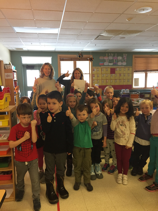 Kindergarten students give a thumbs up to light laboratory materials.