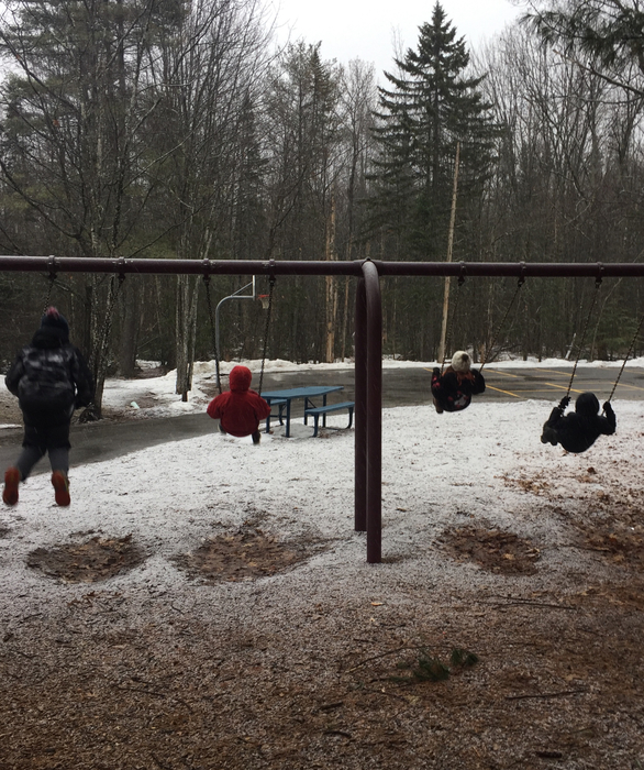 5th graders swinging on a snowy morning