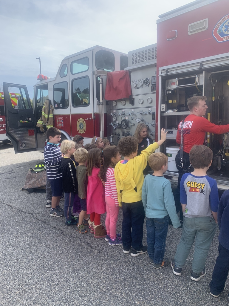 Students learn about the gear on fire trucks.