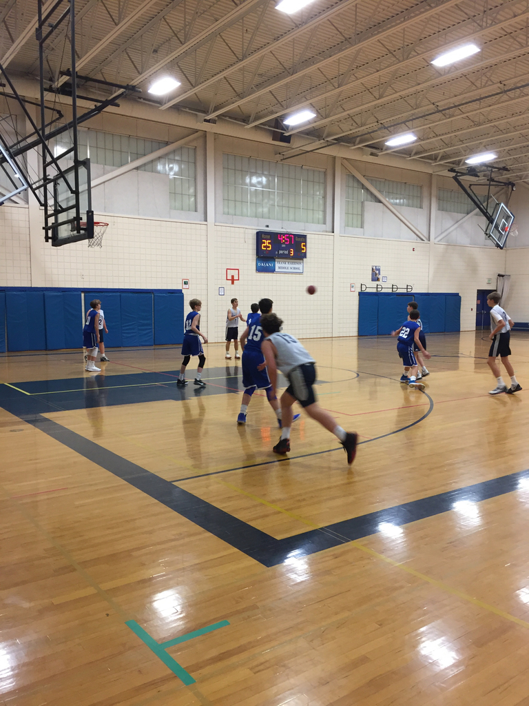 8th grade Boys' Basketball Team in action