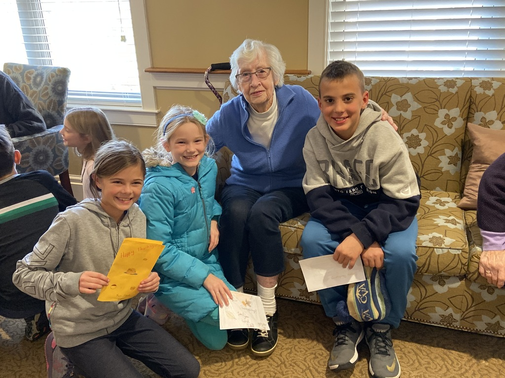 5th graders share Thanksgiving poems and traditions with their senior friends at Bay Square