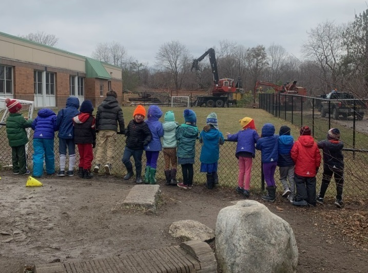 Rowe School students watching the excavator