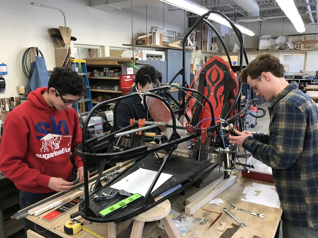 Students working on electric car