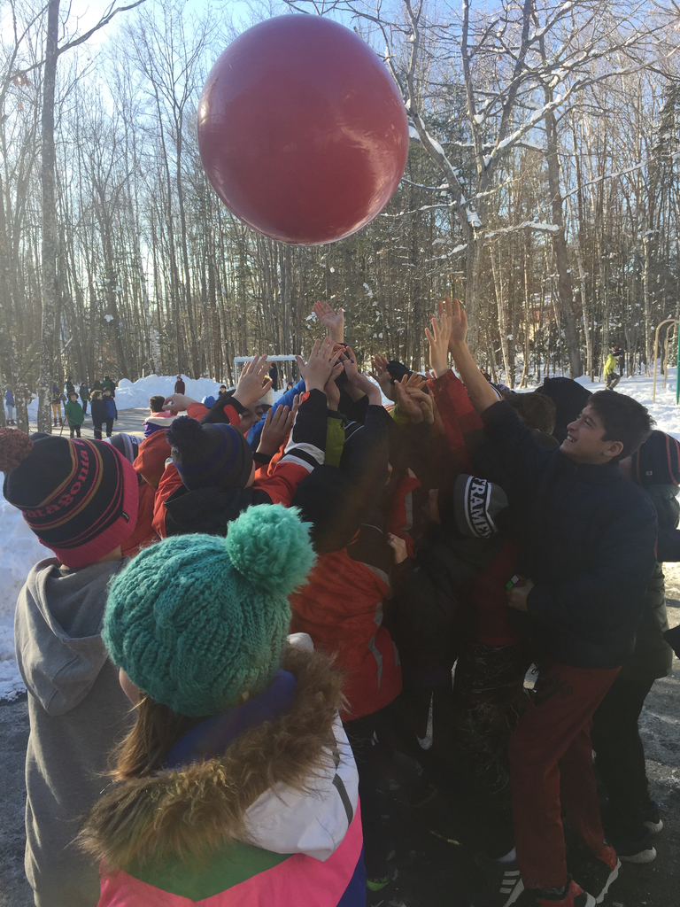 5th graders play with a new ball from the Glow Run fundraiser