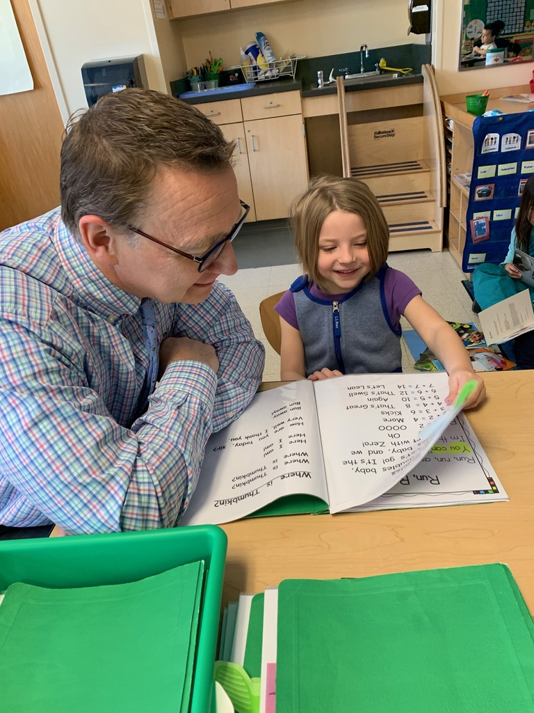 Student reading to Superintendent Dolloff