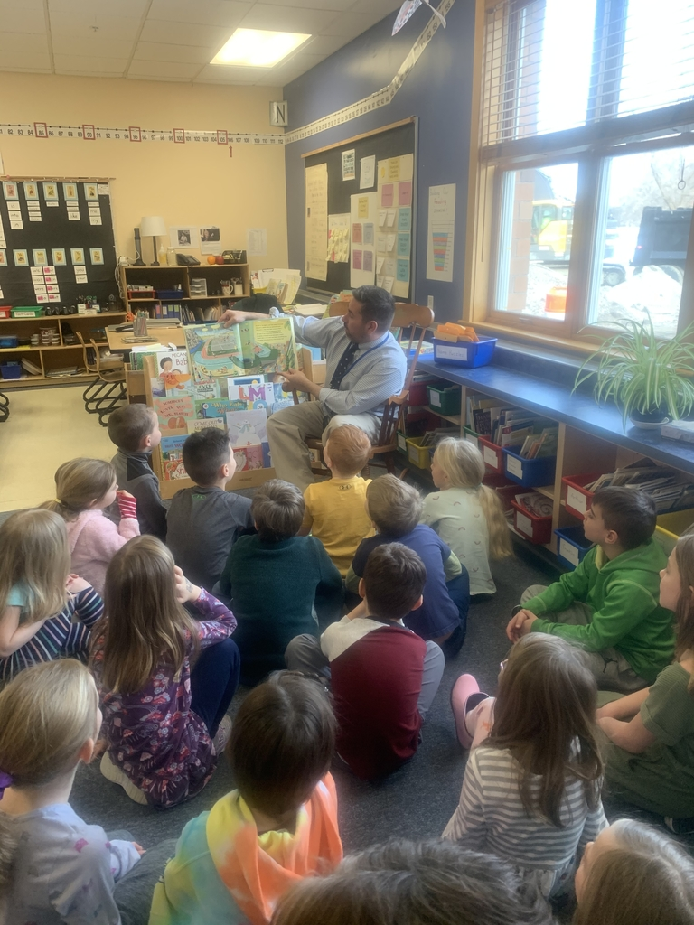 Mr. Gleason reads in a first grade class