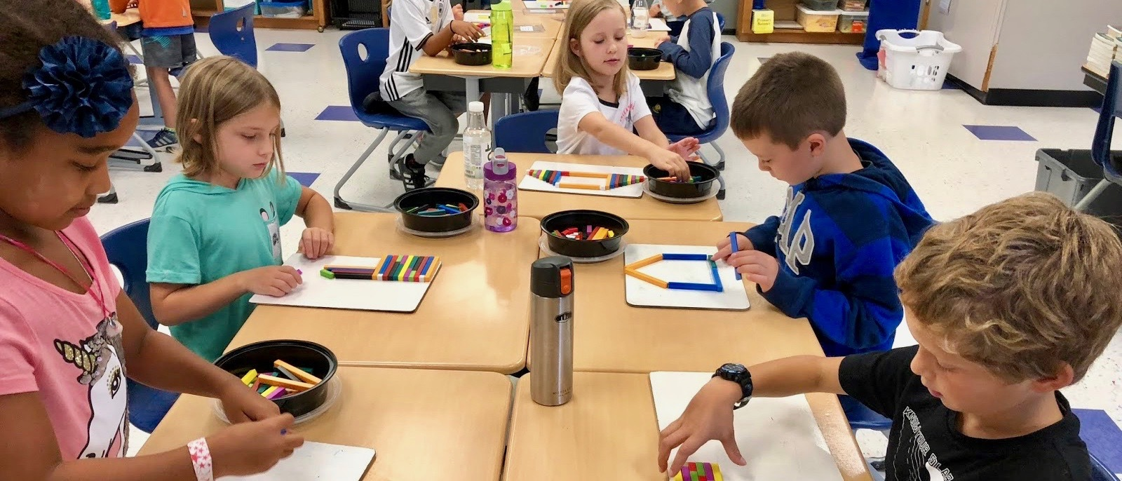 Students use Cuisenaire rods to learn math concepts.