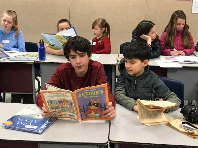 6th grade students read to second grade students